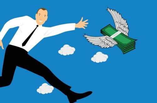 Man chasing money flying away